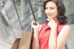 Happy shopping woman with a bag outdoor Royalty Free Stock Photos