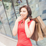 Happy shopping woman with a bag outdoor Stock Image