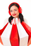 Happy Shopping Woman. Woman With Shopping Bags Looking To The Camera Royalty Free Stock Images