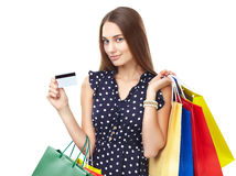 Happy shopping woman with credit Royalty Free Stock Image