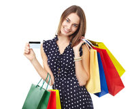 Happy shopping woman with credit Royalty Free Stock Images