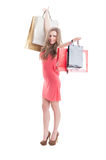 Happy shopping woman expressing joy Stock Photo
