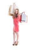 Happy shopping woman expressing joy Stock Photo