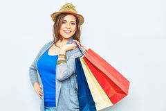 Happy Shopping woman holding bags. beautiful smiling girl portr. Ait on white studio wall background. one woman portrait Royalty Free Stock Image