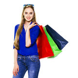 Happy shopping woman holding shopping bags Stock Photo