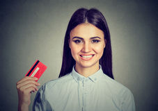 Happy shopping woman holding showing credit card Royalty Free Stock Images