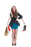 Happy shopping woman laughing Stock Photo
