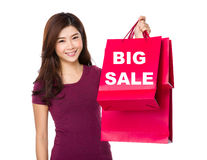 Happy shopping woman raise up the bags showing big sale Royalty Free Stock Photos
