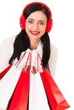 Happy Shopping Woman. With red and white bags Royalty Free Stock Photography