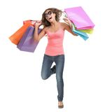 Happy shopping woman running. Cheerful young woman running of happiness after a shopping spree. Full body isolated on white background Stock Photography