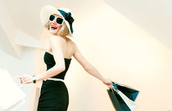 Happy shopping woman with shopping bags in motion Stock Images