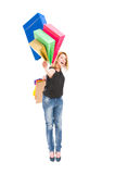 Happy shopping woman throw shopping bags Stock Images