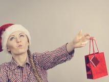 Happy shopping woman wearing Santa hat Stock Photography