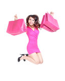 Happy shopping young woman jumping Stock Images