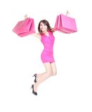 Happy shopping young woman jumping Stock Photos