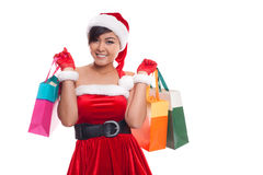 Happy shopping young woman raise arms with bags - isolated on wh. Ite background, asian model Royalty Free Stock Images
