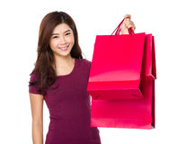 Happy shopping young woman raise arms with bags Royalty Free Stock Photo