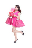 Happy shopping young woman running Stock Photo
