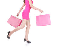 Happy shopping young woman running Royalty Free Stock Photo