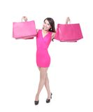 Happy shopping young woman running Stock Image