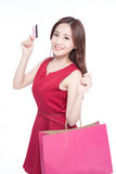 Happy shopping young woman. Show bags and credit card - isolated on white background, asian model beauty Royalty Free Stock Photos