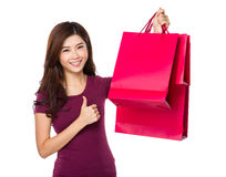Happy shopping young woman show thumb up with bags Stock Photos