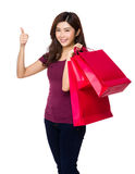Happy shopping young woman show thumb up with bags Royalty Free Stock Photos