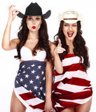 Happy Showy Women Wrapped in USA Flag. Two Ecstatic Showy Women Wrapped in USA Flag royalty free stock photos