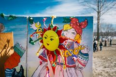 Happy Shrovetide Maslenitsa. Russian traditional spring festival shrove Tuesday poster, outdoors. Happy Shrovetide Maslenitsa. Russian traditional spring stock image
