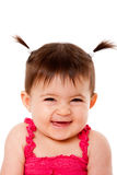 Happy shy laughing baby. Face of cute happy smiling laughing healthy baby infant girl with ponytails giggling, isolated Royalty Free Stock Photography