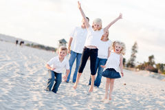 Happy Sibling Children Jumping for Joy Stock Photo