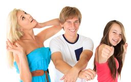 Happy siblings. A boy and two girls stock photo