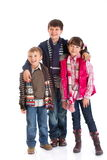 Happy siblings. One sister and two brothers - standing together and posing for camera Stock Photography