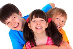 Happy Siblings. A portrait of happy siblings on a white studio background Stock Photo