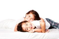 Happy Siblings brother sister. Happy smiling siblings brother sister together laying stock photos
