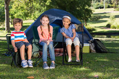 Happy siblings on a camping trip Royalty Free Stock Images