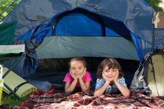 Happy siblings on a camping trip. On a sunny day royalty free stock photo