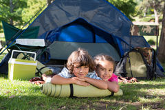 Happy siblings on a camping trip. On a sunny day Royalty Free Stock Images