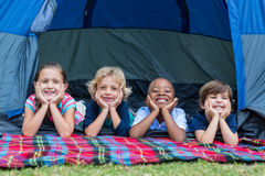 Happy siblings on a camping trip Stock Photos