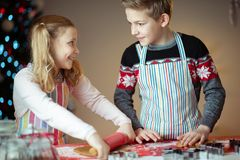 Free Happy Siblings Children Preparing Christmas Cookies At Home With Christmas Tree On Background Stock Photo - 164947690