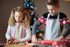 Free Happy Siblings Children Preparing Christmas Cookies At Home With Christmas Tree On Background Royalty Free Stock Photography - 164948277