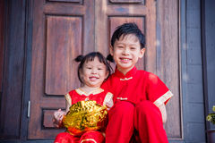 Happy siblings in chinese traditional costume Stock Photography