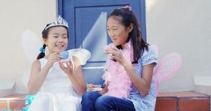 Siblings in fairy costume having a tea party 4k. Happy siblings in fairy costume having a tea party 4k stock footage