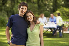 Happy Siblings With Family In Backyard Royalty Free Stock Photography