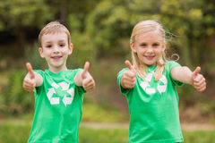 Happy siblings in green with thumbs up Royalty Free Stock Photos