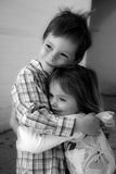 Happy siblings. Hugging each other royalty free stock photography