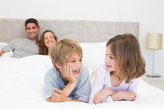 Happy siblings looking at each Royalty Free Stock Photography