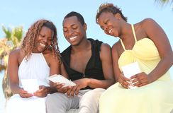 Happy Siblings Looking at Photographs Royalty Free Stock Images