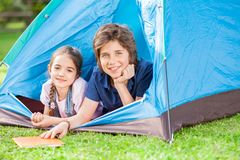 Happy Siblings Lying In Tent Royalty Free Stock Photos