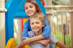 Happy siblings outdoors stock images